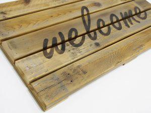 wooden welcome doormat