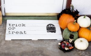 trick or treat wooden doormat